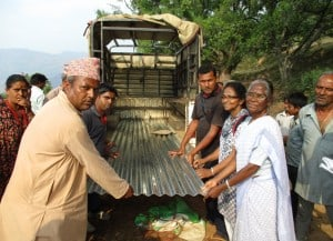 Unloading zinc sheets for temporary shelter