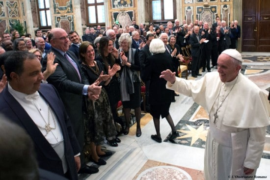Pope Francis at a private audience with JRS staff, supporters and refugees. (photo credit: L'Osservatore Romano)