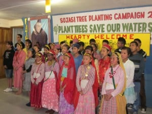 Children at SOJASI in Darjeeling, India, sing under a banner promoting reforestation (Photo: J. Cafiso).
