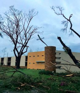 Hurricane Maria damaged the iron cross and buildings of St Ignatius of Loyola College in Puerto Rico.(Photo: Flavio Bravo SJ)