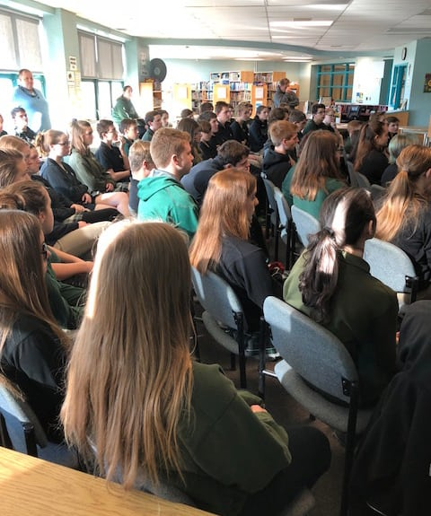 Students listen to Fr Lalit Tirkey SJ at John's High School, Perth, Ontario. (Photo: CJI)