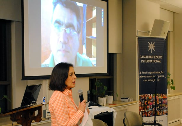 CJI director Jenny Cafiso introduces Fr Roberto Jaramillo (on screen) at the video meeting. (Photo: C. Hincks/CJI)
