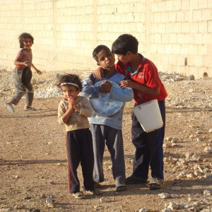 Syrian children play near a JRS field kitchen in Damascus (Photo: JRS Syria)