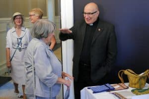 Fr David Creamer in conversation with a guest