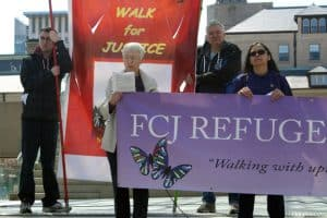 Sr Lois Anne Bordowitz FCJ speaks at the third station with members of the FCJ Refugee Centre