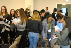 Y4O students mingle in a get-to-know-you exercise.