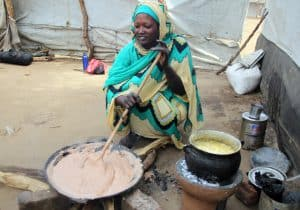 Lelia prepares food for her family in Gendrassa Refugee Camp in Maban, South Sudan. (Photo: A. Wells/JRSEA)