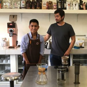 José Angel Gómez Hernández (left), a worker at the Bat'sil Maya coffee laboratory in Chilón, Mexico, stands with Alejandro Castro, the director of Capeltic, a social enterprise in the Tseltal community.